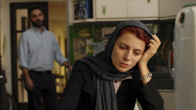 """FILE - In this undated file photo released by Filmiran film distributing company, Iranian actress Leila Hatami, and actor Peyman Moadi, act in a scene of movie """"A Separation"""" which won the Academy Awards in foreign films. Iranian authorities canceled a ceremony Monday in honor of the country's Oscar-winning director even though the government had hailed his win as a triumph over a competitor from Israel. There were no details as to why a permit was denied but some Iranian conservatives were upset with the film's themes: domestic turmoil, gender inequality and the desire by many to leave the country. (AP Photo/Filmiran International Company, Habib Majidi, File)"""