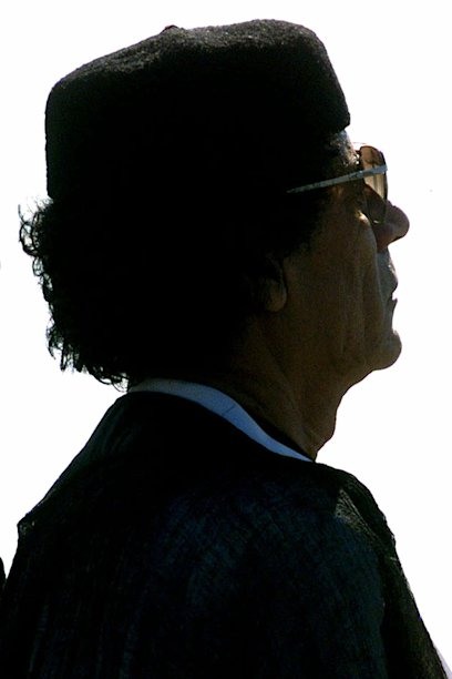 In this June 13, 1999 photo,  Libyan leader Moammar Gadhafi  is photographed in Cape Town, South Africa.     A U.S. official says Libya's new government has told the United States that Gadhafi, 69,  is dead. The official said Libya's Transitional National Council informed U.S. officials in Libya of the development Thursday, Oct. 20, 2011.  His death on Thursday, confirmed by Prime Minister Mahmoud Jibril, came as Libyan fighters defeated Gadhafi's last holdouts in his hometown of Sirte, the last major site of resistance in the country.  (AP Photo/Peter DeJong)