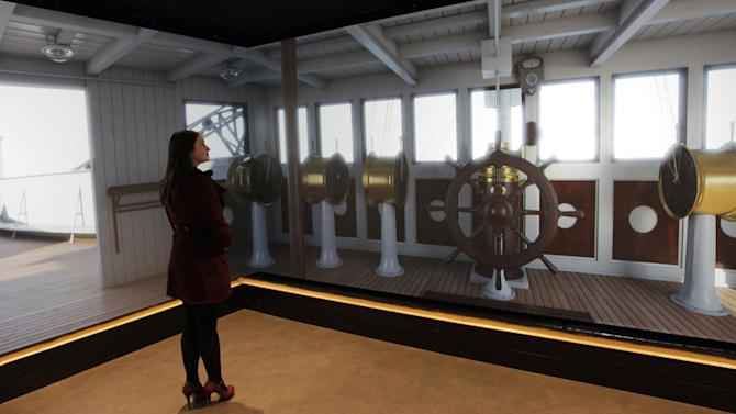 FILE - In this Tuesday March 13, 2012 file photo, a woman looks at projections of the inside of the Titanic on display in the newTitanic Belfast Visitor's Center in Belfast, Northern Ireland. April 15, 2012 is the 100th anniversary of the sinking of the Titanic, just five days after it left Southampton on its maiden voyage to New York. (AP Photo/Peter Morrison, File)