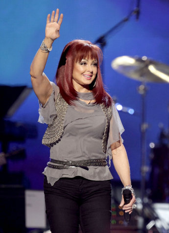 FILE - In this April 4, 2011 file photo, country singer Naomi Judd performs at the Girls&#39; Night Out: Superstar Women of Country in Las Vegas. Judd is hosting a limited-run talk show on SiriusXM called &quot;Think Twice.&quot; Her first guest will be Ashley Judd, June 8. (AP Photo/Julie Jacobson, file)