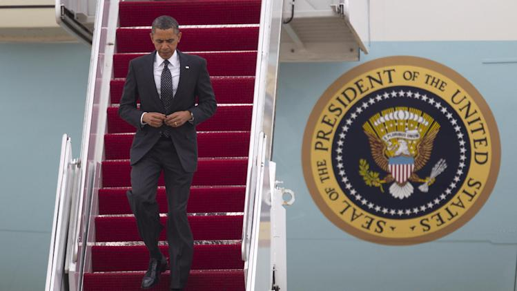 President Barack Obama steps off Air Force One at Andrews Air Force Base, Md., Tuesday, May 2, 2012,  after a secret trip to Afghanistan.  (AP Photo/Evan Vucci)