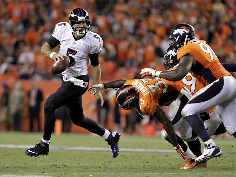 Baltimore Ravens quarterback Joe Flacco (5) is pressured by Denver Broncos safety Duke Ihenacho (33) and Robert Ayers (91) during the second half of an NFL football game, Thursday, Sept. 5, 2013, in Denver. (AP Photo/Joe Mahoney)
