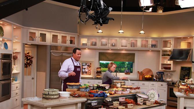 """This undated publicity photo provided by QVC, shows QVC program host David Venable and Tara McConnell on set from Temp-tations during one of QVC's """"In the Kitchen with David ®"""" broadcasts. (AP Photo/QVC)"""