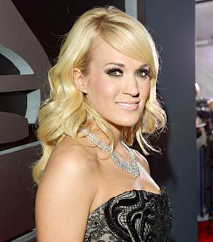 "Carrie Underwood Tweets Rage Over Passing of Ag Gag Bill, State Rep Tells Her to ""Stick to Singing"""
