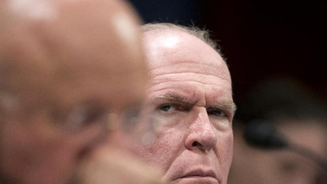 CIA Director John Brennan listens at right as National Intelligence Director James Clapper testifies on Capitol Hill in Washington, Thursday, April 11, 2013, before the House Intelligence Committee hearing on worldwide threats.   (AP Photo/Manuel Balce Ceneta)