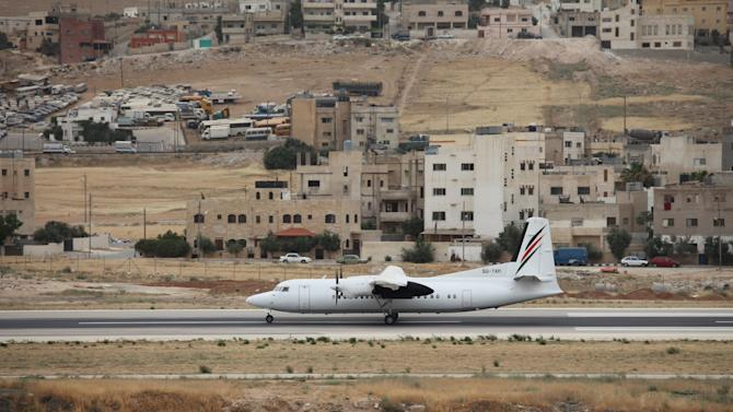 A Palestinian Airlines flight takes off from Marka Airbase to El-Arish, Egypt, in Amman, Jordan, Sunday, May 27, 2012. Palestinian Airlines is back in the skies after being grounded for seven years by the vagaries of the Mideast conflict. It's a mom-and-pop operation, with just two 48-seat turbo-prop planes, two weekly flights and a borrowed hub in Egypt, but Palestinians say just being on the map again is what matters. (AP photo/Mohammad Hannon)