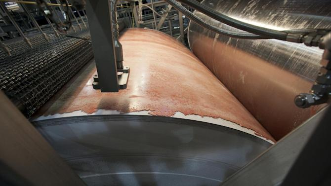 "FILE - In this March 29, 2012 file photo, the beef product known as pink slime or lean finely textured beef is frozen on a large drum as part of its manufacturing process at the Beef Products Inc.'s plant in South Sioux City, Neb. Beef Products Inc. plans to file a defamation lawsuit in the wake of a publicity storm over a meat product that critics have dubbed ""pink slime."" The Dakota Dunes, S.D.-based company said Wednesday, Sept. 12, 2012 that it will announce a lawsuit Thursday. A company executive and lawyer refused to name the defendant. (AP Photo/Nati Harnik, File)"
