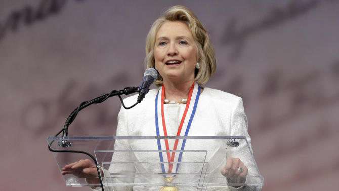 Former Secretary of State Hillary Rodham Clinton speaks after receiving the Liberty Medal during a ceremony at the National Constitution Center, Tuesday, Sept. 10, 2013, in Philadelphia. The honor is given annually to an individual who displays courage and conviction while striving to secure liberty for people worldwide. (AP Photo/Matt Rourke)
