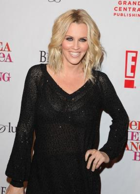 Jenny McCarthy is all smiles at Chelsea Handler's book party for 'Chelsea Chelsea Bang Bang' at Bar 210/Plush at the Beverly Hilton Hotel in Beverly Hills, California on March 17, 2010  -- Getty Images