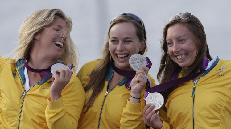 From left to right: Australia's Elliot 6m crew Ninca Curtis, Lucinda Whitty and Olivia Price celebrate after winning the silver medal at the London 2012 Summer Olympics, Saturday, Aug. 11, 2012, in Weymouth and Portland, England. (AP Photo/Bernat Armangue)