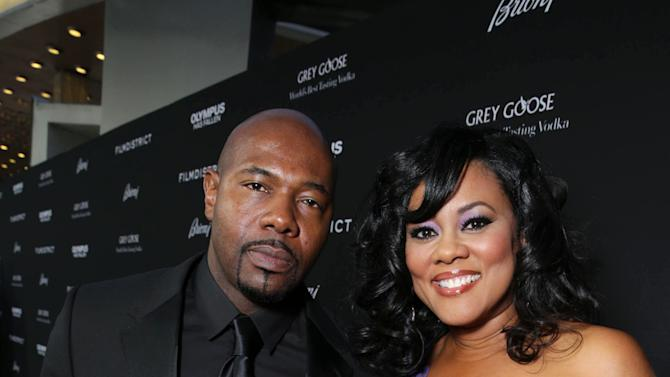 Director Antoine Fuqua and Lela Rochon at FilmDistrict's Premiere of 'Olympus Has Fallen' hosted by Brioni and Grey Goose at the ArcLight Hollywood, on Monday, March, 18, 2013 in Los Angeles. (Photo by Eric Charbonneau/Invision for FilmDistrict/AP Images)