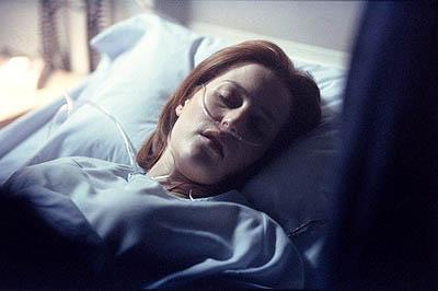 "A pregnant Dana Scully (Gillian Anderson) is rushed to the hospital with abdominal pains in the ""Empedocles"" episode of Fox's The X-Files X-Files"