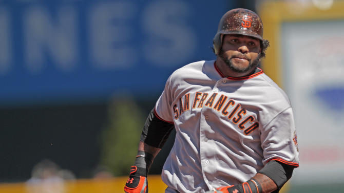 San Francisco Giants' Pablo Sandoval rounds second on a triple off a pitch by Colorado Rockies' Esmil Rogers during the first inning of a baseball game Sunday, Sept. 18, 2011 in Denver. (AP Photo/Barry Gutierrez)