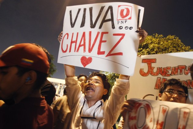Peru's supporters of Venezuelan President Hugo Chavez shout slogans while gathering outside Venezuela's embassy in Lima