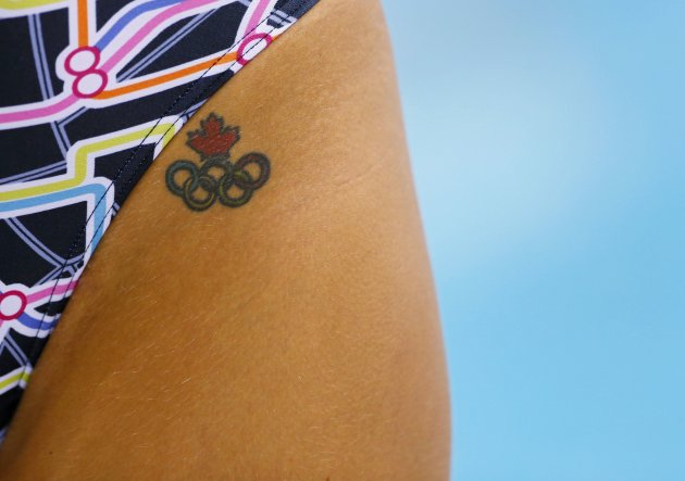 A Canadian swimmer sports an Olympic rings tattoo at the Aquatics Centre before the start of the London 2012 Olympic Games in London