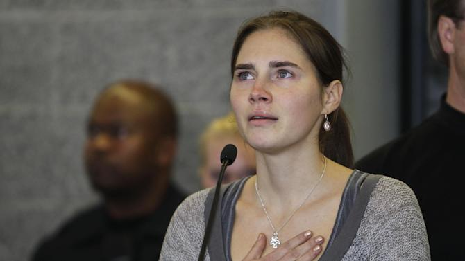FILE - In this Oct. 4, 2011 file photo Amanda Knox gestures at a news conference in Seattle, after returning home from Italy. Italy's highest court overturns Friday, March 27, 2015 Amanda Knox murder conviction, closing legal saga. (AP Photo/Ted S. Warren, File)
