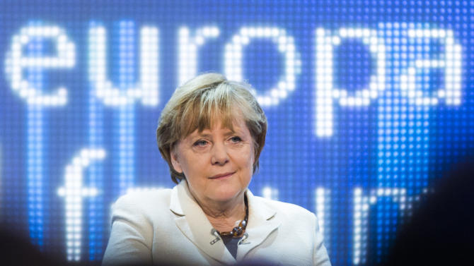 """German Chancellor Angela Merkel attends a discussion panel on """"making Europe strong"""" during the Europe forum conference, organized by German public-broadcaster WDR, in Berlin, Germany, Thursday, May 16, 2013. (AP Photo/Gero Breloer)"""
