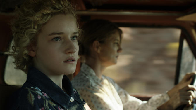 """This undated publicity film image released by Phase 4 Films shows Julia Garner, left, as Rachel, in a scene from the film, """"Electrick Children."""" (AP Photo/Phase 4 Films)"""