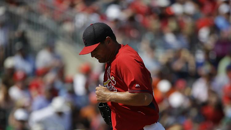 St. Louis Cardinals pitcher Tyler Lyons is relieved in the fourth inning of an exhibition spring training baseball game against the Detroit Tigers, Monday, March 10, 2014, in Jupiter, Fla. (AP Photo/David Goldman)