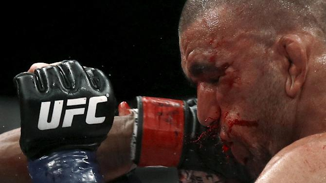 Issa of Brazil receives a punch of Alcantara of Brazil during their UFC match in Rio de Janeiro