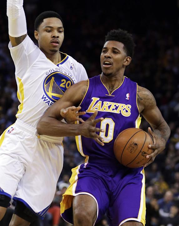 Golden State Warriors' Kent Bazemore, left, guards Los Angeles Lakers' Nick Young (0) during the first half of an NBA basketball game Saturday, Dec. 21, 2013, in Oakland, Calif