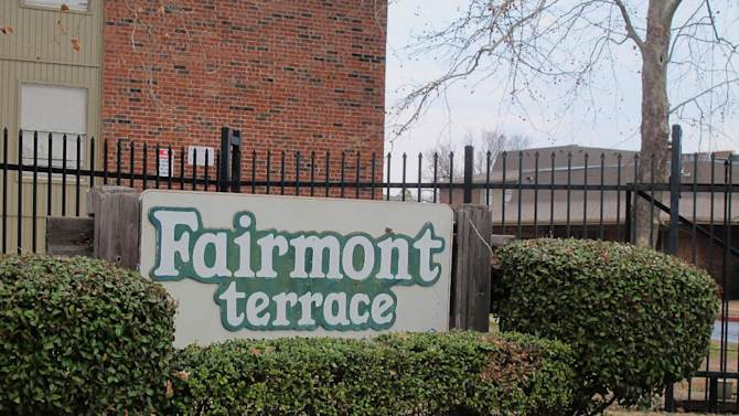 The entrance to the Fairmont Terrace apartment complex in south Tulsa is seen on Thursday, Feb. 7, 2013 in Tulsa, Okla. The complex was the site of a brutal quadruple murder last month, and investigators announced they arrested two brothers in connection with the crimes this week.  (AP Photo/Justin Juozapavicius)