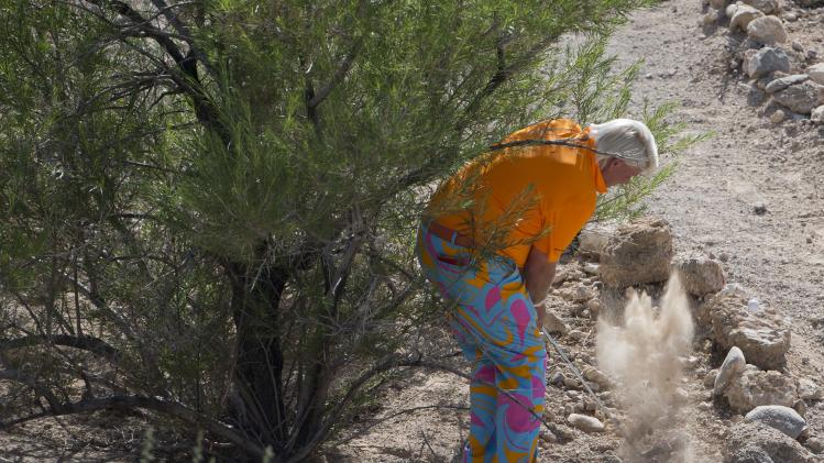 John Daly takes his second of three shots in the rough on the third hole during the third round of the Justin Timberlake Shriners Hospitals for Children Open golf tournament, Saturday, Oct. 6, 2012, in Las Vegas. (AP Photo/Julie Jacobson)