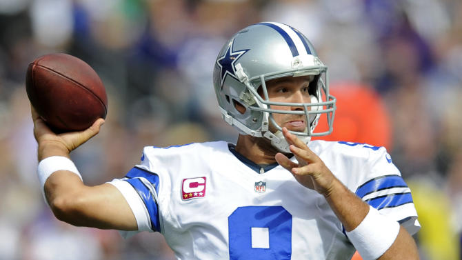 Dallas Cowboys quarterback Tony Romo throws to a receiver in the first half of an NFL football game against the Baltimore Ravens in Baltimore, Sunday, Oct. 14, 2012. (AP Photo/Nick Wass)