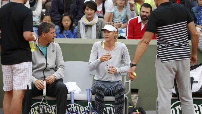 Maria Sharapova of Russia listens to her coach Sven Groeneveld during a training session for the French Open tennis tournament at the Roland Garros stadium in Paris