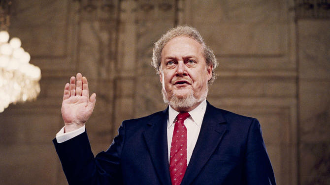 "FILE - In this Sept. 15, 1987, file photo, Judge Robert Bork, nominated by President Reagan to be an associate justice of the Supreme Court, and who's nomination ultimately failed in the Senate, is sworn before the Senate Judiciary Committee on Capitol Hill at his confirmation hearing. Bork says President Richard Nixon promised him the next Supreme Court vacancy after Bork complied with Nixon's order to fire Watergate special prosecutor Archibald Cox in 1973. Bork's recollection of his role in the Saturday Night Massacre that culminated in Cox's firing is at the center of his slim memoir, ""Saving Justice,"" that is being published posthumously by Encounter Books. Bork died in December 2012 at age 85.  Bork writes that he didn't know if Nixon actually, though mistakenly, believed he still had the political clout to get someone confirmed to the Supreme Court or was just trying to secure Bork's continued loyalty as his administration crumbled in the Watergate scandal. (AP Photo/John Duricka)"