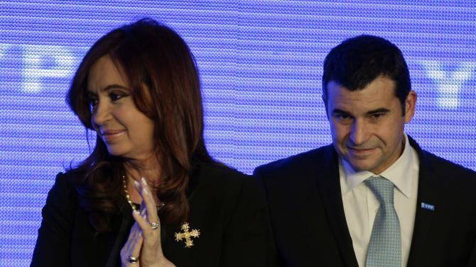 Argentina's President Cristina Fernandez, left, and YPF's General Manager Miguel Gallucio smile during a ceremony to announce new investments in YPF in Buenos Aires, Argentina, Tuesday, June 5, 2012. Galuccio announced a five-year plan that includes an investment of up to $7 billion annually to expand exploration and boost production. (AP Photo/Natacha Pisarenko)