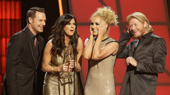 "Musical group Little Big Town, from left, Jimi Westbrook, Karen Fairchild, Kimberly Schlapman and Phillip Sweet, accept the award for single of the year for ""Pontoon"" at the 46th Annual Country Music Awards at the Bridgestone Arena on Thursday, Nov. 1, 2012, in Nashville, Tenn. (Photo by Wayde Payne/Invision/AP)"