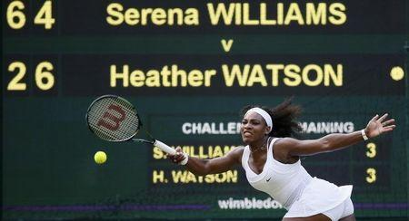 Serena Williams of the U.S.A. hits the ball during her match against Heather Watson of Britain at the Wimbledon Tennis Championships in London