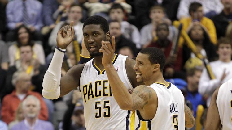 Indiana Pacers center Roy Hibbert (55) and guard George Hill (3) hold up their fingers going into a time out while playing the New York Knicks during the first half of an NBA basketball game in Indianapolis, Wednesday, Feb. 20, 2013. (AP Photo/AJ Mast)