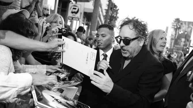 Director Tim Burton arrives at the premiere of Disney's stop-motion animated full length black and white film 'Frankenweenie' directed by Tim Burton on Monday Sept. 24, 2012, in Los Angeles. (Photo by Jordan Strauss/Invision for Disney/AP Images)