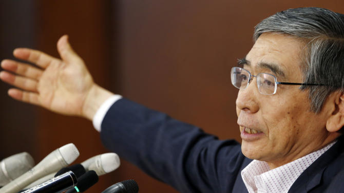 """Bank of Japan Gov. Haruhiko Kuroda speaks during a news conference after attending a policy meeting at the BOJ's head office in Tokyo Tuesday, June 11, 2013. Japan's central bank has ended a two-day policy meeting with an upbeat assessment for the world's No. 3 economy and a pledge to persist with its aggressive monetary easing policies aimed at ending years of growth-sapping deflation. The Bank of Japan said Tuesday that the economy was picking up, supported by government and consumer spending, and it expects the rate of change in the inflation benchmark to """"gradually turn positive."""" (AP Photo/Koji Sasahara)"""