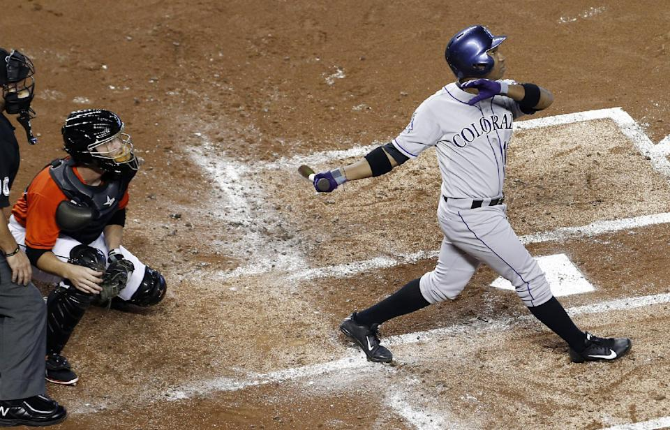 Arenado helps Rockies beat Marlins 4-3