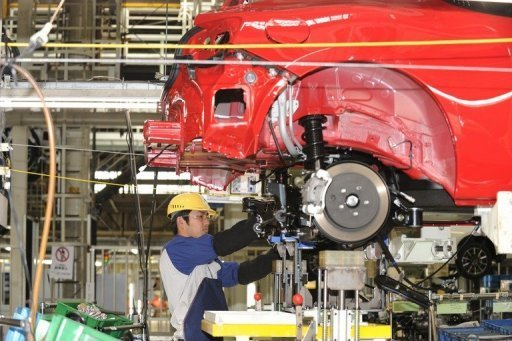 <p>This file photo shows a worker of Fuji Heavy Industries assembling a car on a production line in Ota-city, Gunma prefecture. Japan's factory output fell by a bigger-than-expected 4.1 percent in September, the industry ministry said on Tuesday, data likely to fuel worries about the world's third-biggest economy.</p>