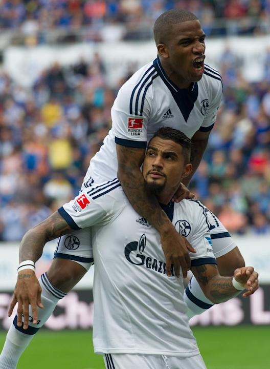 Schalke's Kevin-Prince Boateng, bottom, celebrates with Jefferson Farfan, top, after scoring during the German first division Bundesliga soccer match between TSG 1899 Hoffenheim and Schalke 04 in Sins
