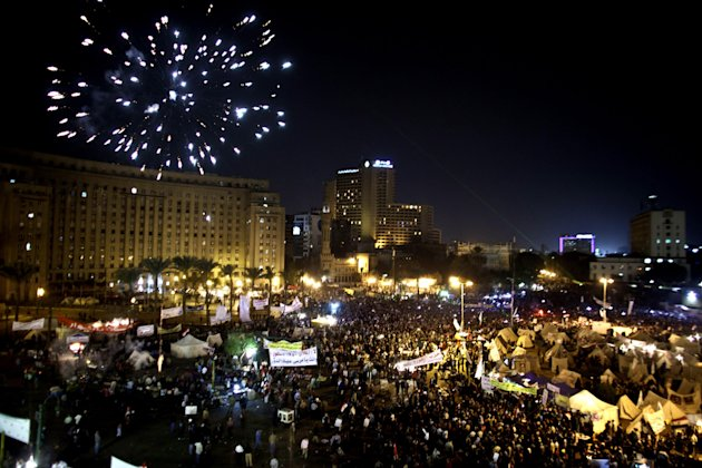 Fireworks burst over Tahrir Square as protesters gather in Cairo, Egypt, Tuesday, Dec. 4, 2012. A protest by tens of thousands of Egyptians outside the presidential palace in Cairo turned violent on Tuesday as tensions grew over Islamist President Mohammed Morsi&#39;s seizure of nearly unrestricted powers Thousands of protesters also gathered in Cairo&#39;s downtown Tahrir Square, miles away from the palace, to join several hundred who have been camping out there for nearly two weeks. (AP Photo/Maya Alleruzzo)