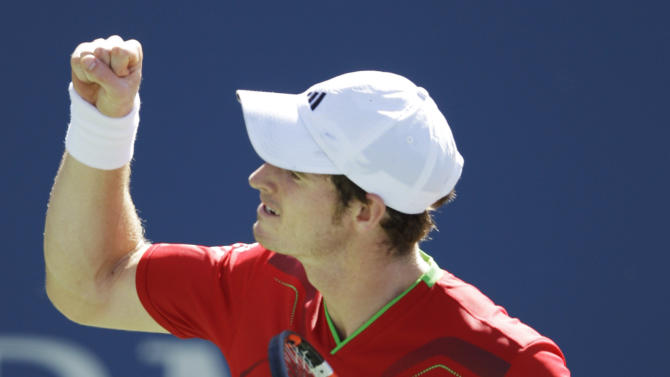Andy Murray of Britain reacts after winning the second set against John Isner during a quarterfinal match at the U.S. Open tennis tournament in New York, Friday, Sept. 9, 2011. (AP Photo/Matt Slocum)