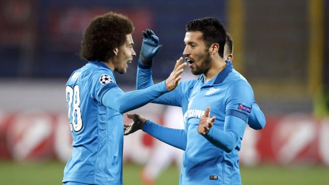 Zenit St. Petersburg's Axel Witsel and Ezequiel Garay celebrate after winning against Benfica during their Champions League soccer match in St. Petersburg
