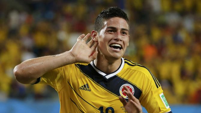 Colombia's James Rodriguez celebrates after scoring a goal during the 2014 World Cup Group C soccer match between Japan and Colombia at the Pantanal arena