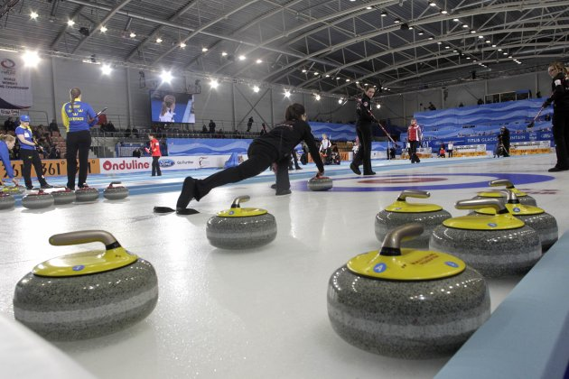 Athletes from Canada compete during their World Women's Curling Championship qualification round against Switzerland in Riga