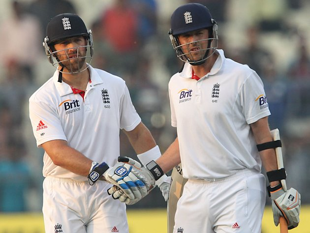 England's Matt Prior congratulations Graeme Swann at the end of Day 3 of the cricket Test match against India at the Eden Gardens in Kolkata. (BCCI)