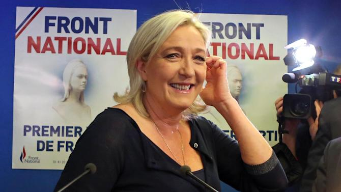 Far right party National Front leader Marine Le Pen poses for photographers before addressing reporters at the party's headquarters in Nanterre, west of Paris, Sunday May 25, 2014, following the victory of her party in the European Elections.(AP Photo/Remy de la Mauviniere)