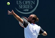 Xavier Malisse of Belgium serves to Matthew Ebden of Australia during day four of the Farmers Classic Presented By Mercedes-Benz at LA Tennis Center at the University of California, Los Angeles, on July 26. Malisse reached the quarter-finals after some last-minute changes to his serve which the fifth seed used to overpower Ebden 6-4, 6-3