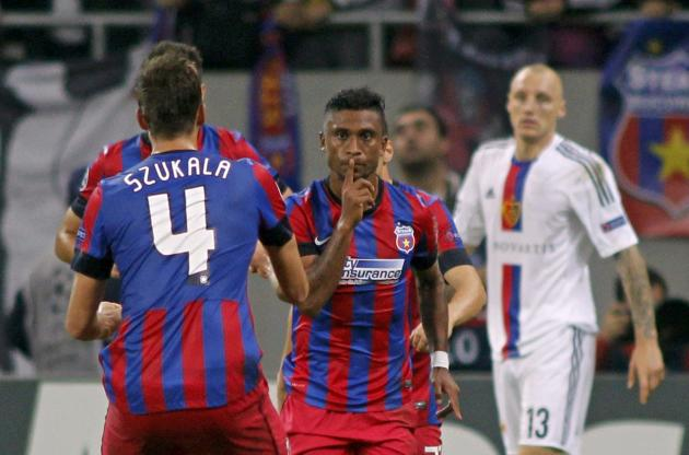 Tatu of Steaua Bucharest celebrates his goal against Basel with team mate Lukasz Szukala during their Champions League soccer match at the National Arena in Bucharest