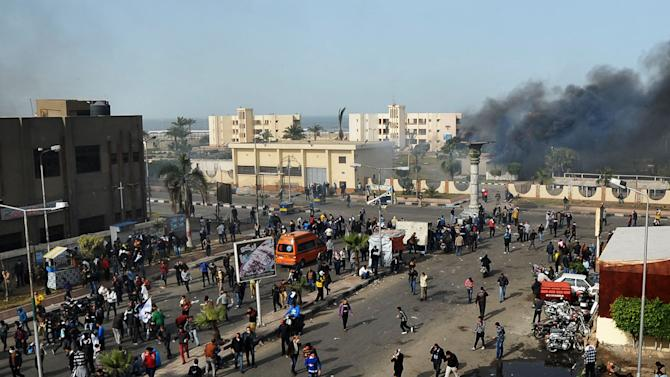 Egyptian protesters clash with police, unseen, in Port Said, Egypt, Sunday, Jan. 27, 2013. Violence erupted briefly when some in the crowd fired guns and police responded with volleys of tear gas, witnesses said. State television reported 110 were injured. Egyptian health officials say 3 have been killed in clashes between protesters and police in Port Said. (AP Photo)