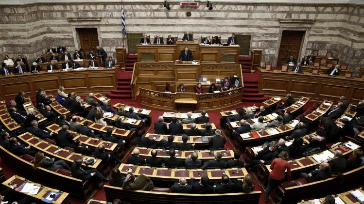 Deputy Prime Minister Evangelos Venizelos delivers a speech during a parliament session where lawmakers vote on the 2014 budget in Athens